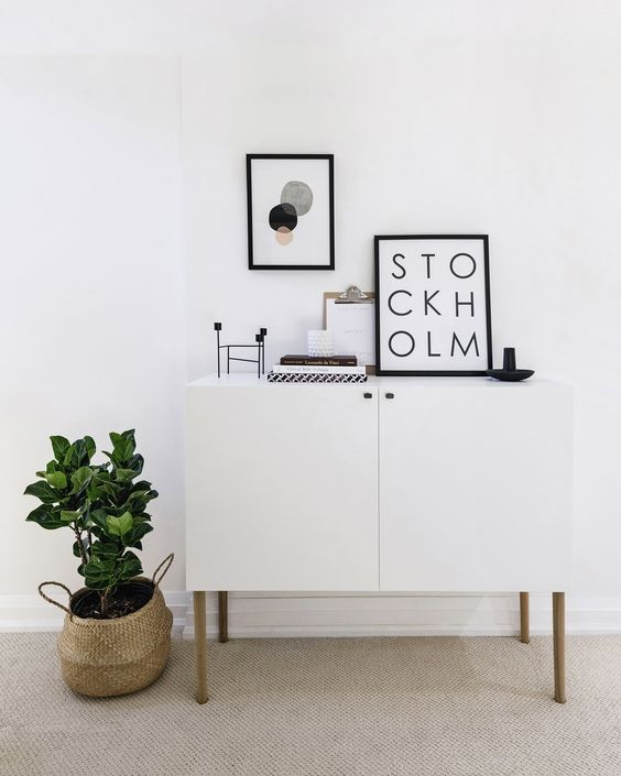 IKEA Besta hack with legs and little knobs to fit a Scandinavian interior