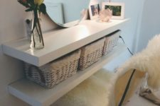 15 IKEA Lack shelves turned into a narrow floating vanity with baskets for storage – ideal for a small space