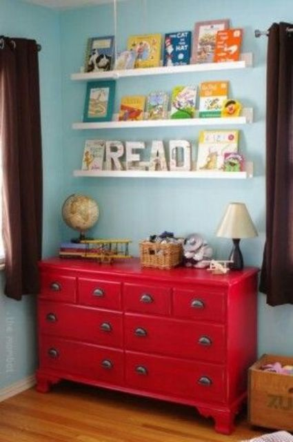 a hot red Hemnes dresser with cool metal handles for a colorful kids' room