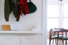17 a floating vanity and storage boxes under the top are great for a small space