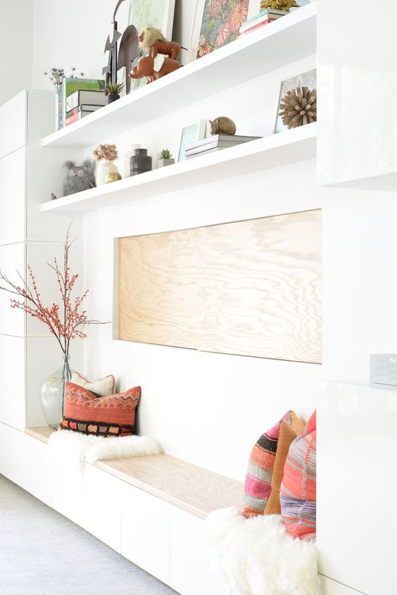 a built-in bench with storage and a light-colored wooden seat for a chic look