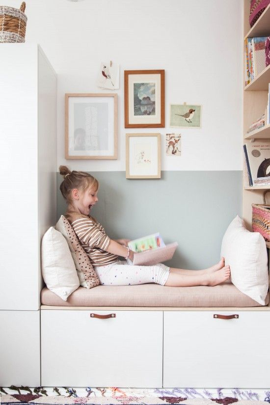 a built in storage bench with leather pulls can be ideal for a child or just as a reading nook