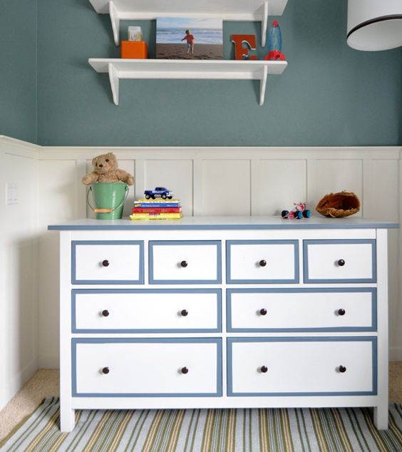 a white Hemnes dresser with powder blue frames and black knobs for a boy's room