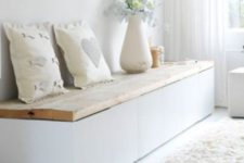 20 a minimalist bench of IKEA Besta with a wooden top that can be raised for storage