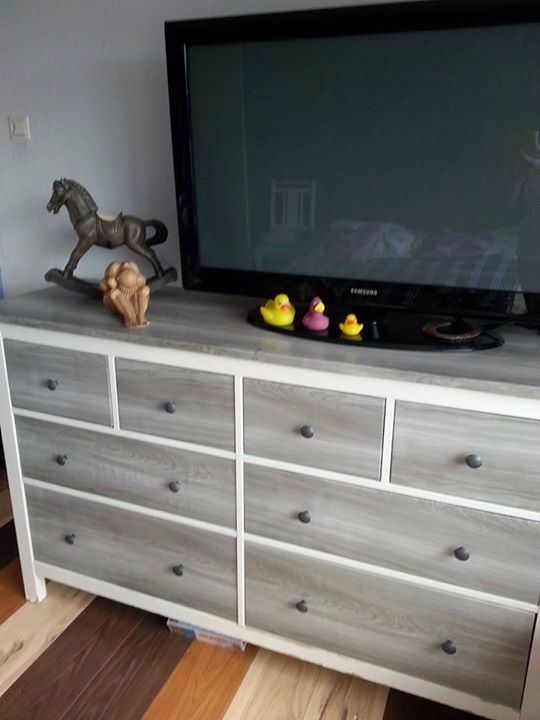 a white Hemnes spruced up with grey toned drawers and top and wooden knobs for a rustic feel