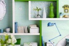 22 a creative and colorful shelving unit of Lack in white and green with wallpaper for accents