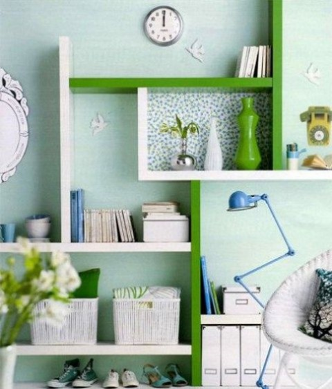 a creative and colorful shelving unit of Lack in white and green with wallpaper for accents