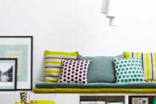 23 IKEA Besta hack into a comfy bench with storage and colorful upholstery and pillows
