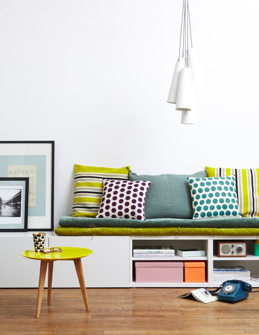 IKEA Besta hack into a comfy bench with storage and colorful upholstery and pillows