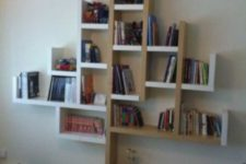 23 a creative tree-shaped shelving unit of white and natural stain wood made of Lack shelves