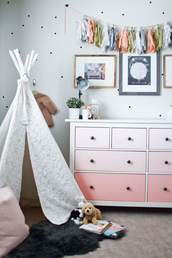 an ombre peachy pink IKEA Hemnes dresser with black knobs for a girl's room