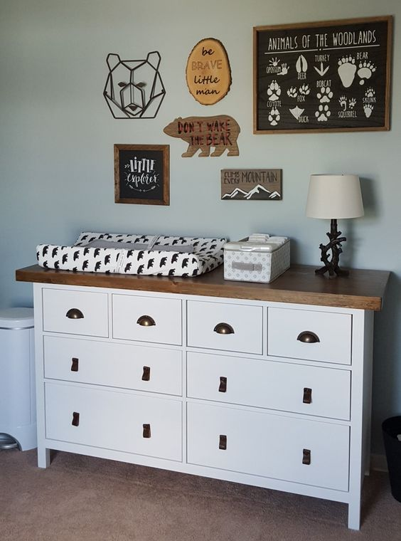 Ikea Hemnes dresser with leather pulls and metal handles and a wooden top for a rustic changing table