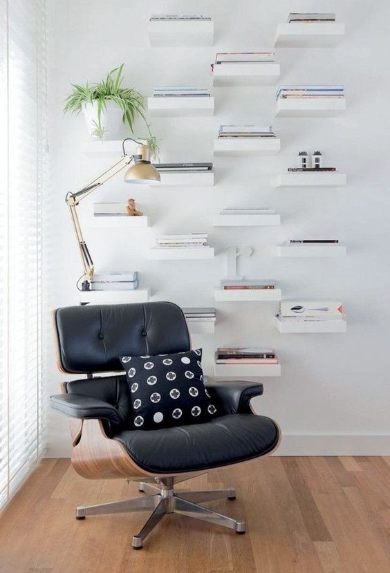 a stylish reading nook done with IKEA Lack shelves is a simple and stylish idea