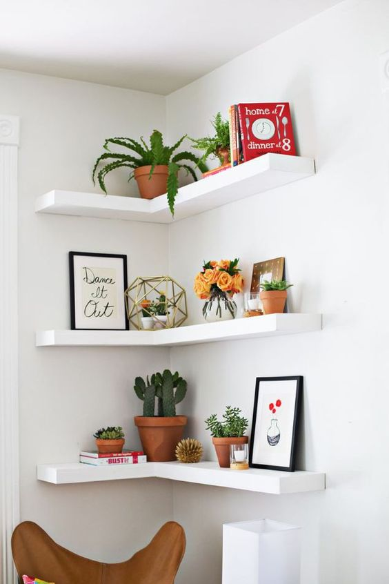 decorate an awkward corner with floating IKEA Lack shelves to get maximum of this space