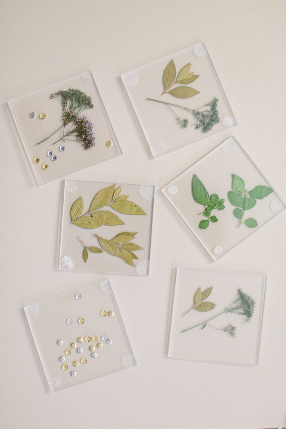 DIY transparent glass botanical coasters (via www.100layercake.com)