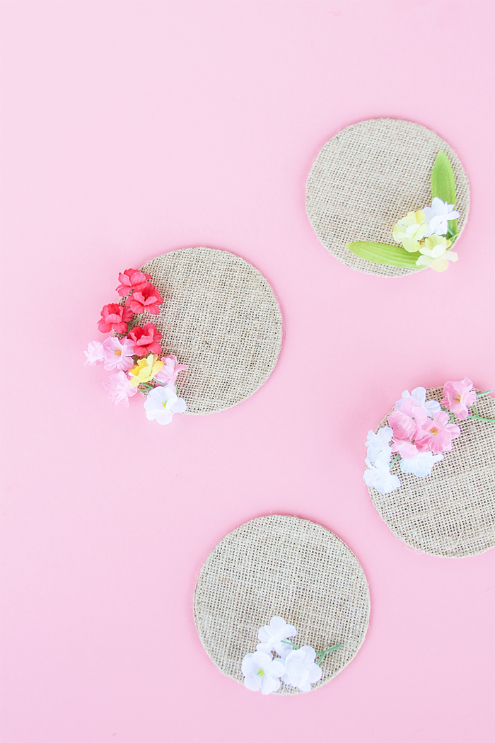 DIY floral fabric coasters with plastic blooms