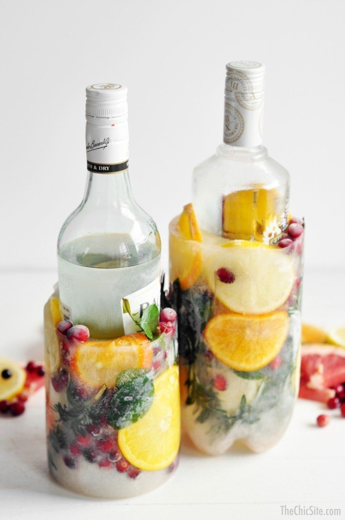 DIY ice buckets with citrus, berries and greenery