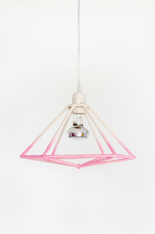 DIY ombre pink geometric lampshade of BBQ sticks and yarn (via www.shelterness.com)