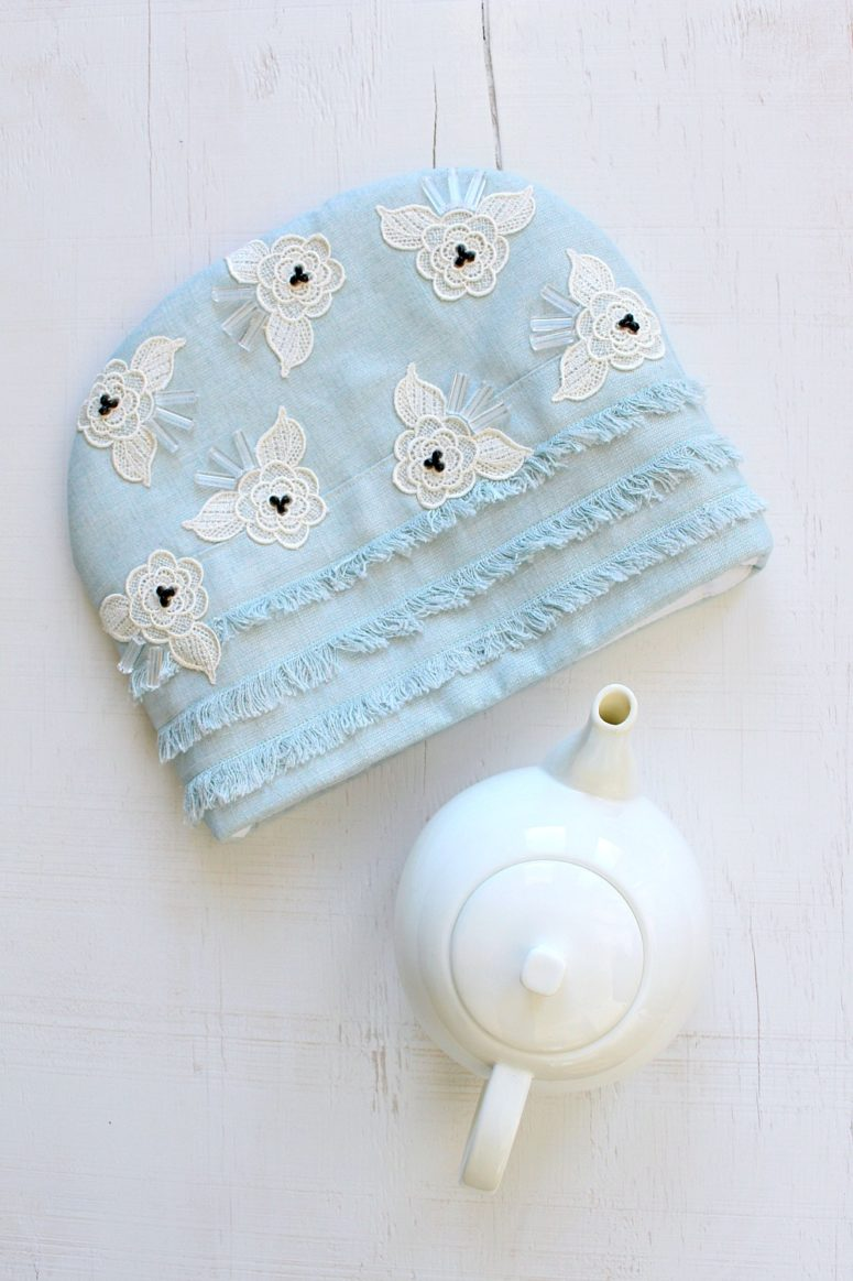 DIY blue tea cozy with lace and bead appliques (via www.danslelakehouse.com)