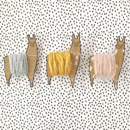 DIY cardboard and yarn llama bobbins