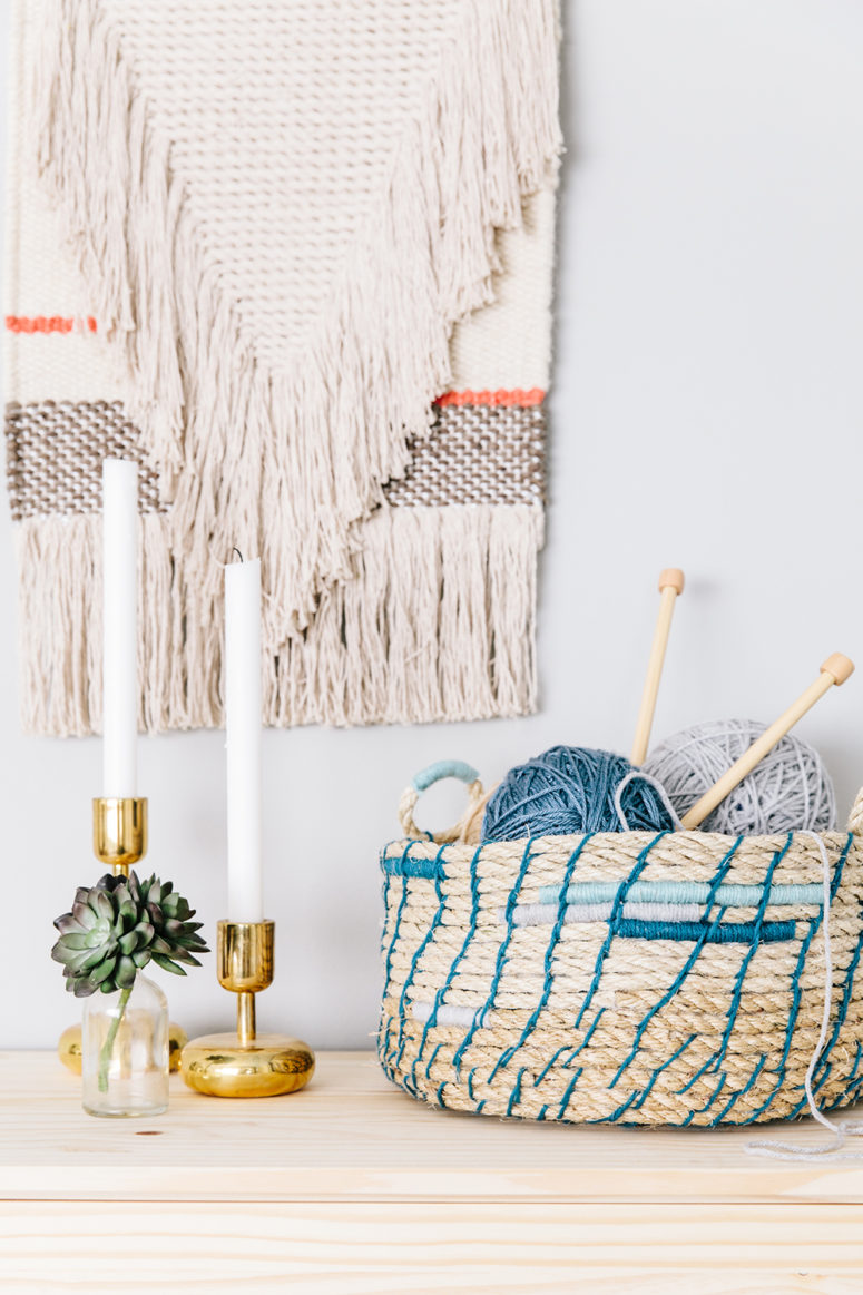 DIY rope basket with blue yarn decor (via thehousethatlarsbuilt.com)