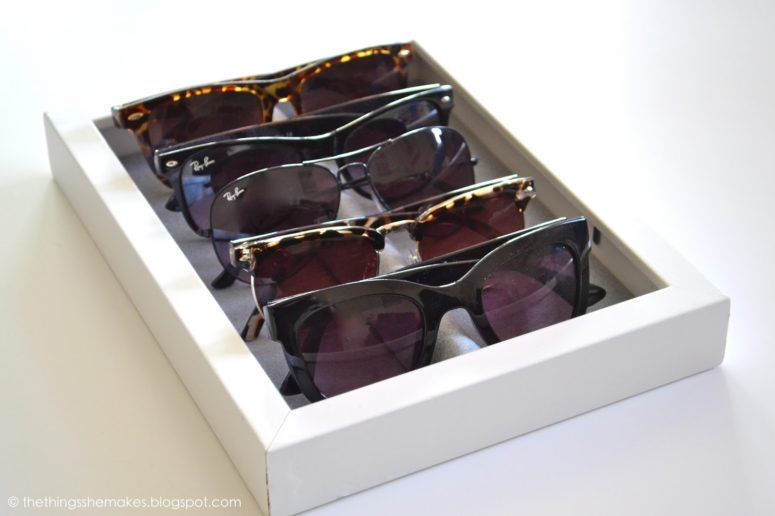 DIY sunglasses tray of an IKEA Ribba frame (via thethingsshemakes.blogspot.com)