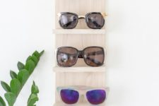 DIY light-colored wooden sunglasses shelf