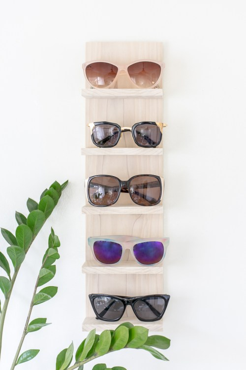 DIY light-colored wooden sunglasses shelf (via diyinpdx.com)