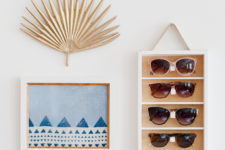 DIY hanging wall shelf with sunglasses