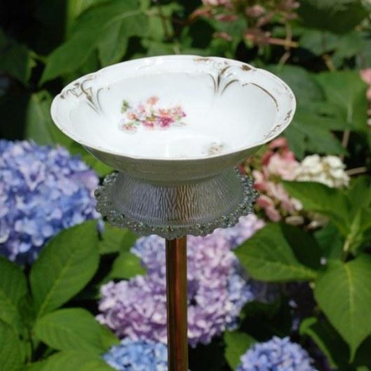 DIY bird bath of a vintage bowl (via www.mysocalledcraftylife.com)