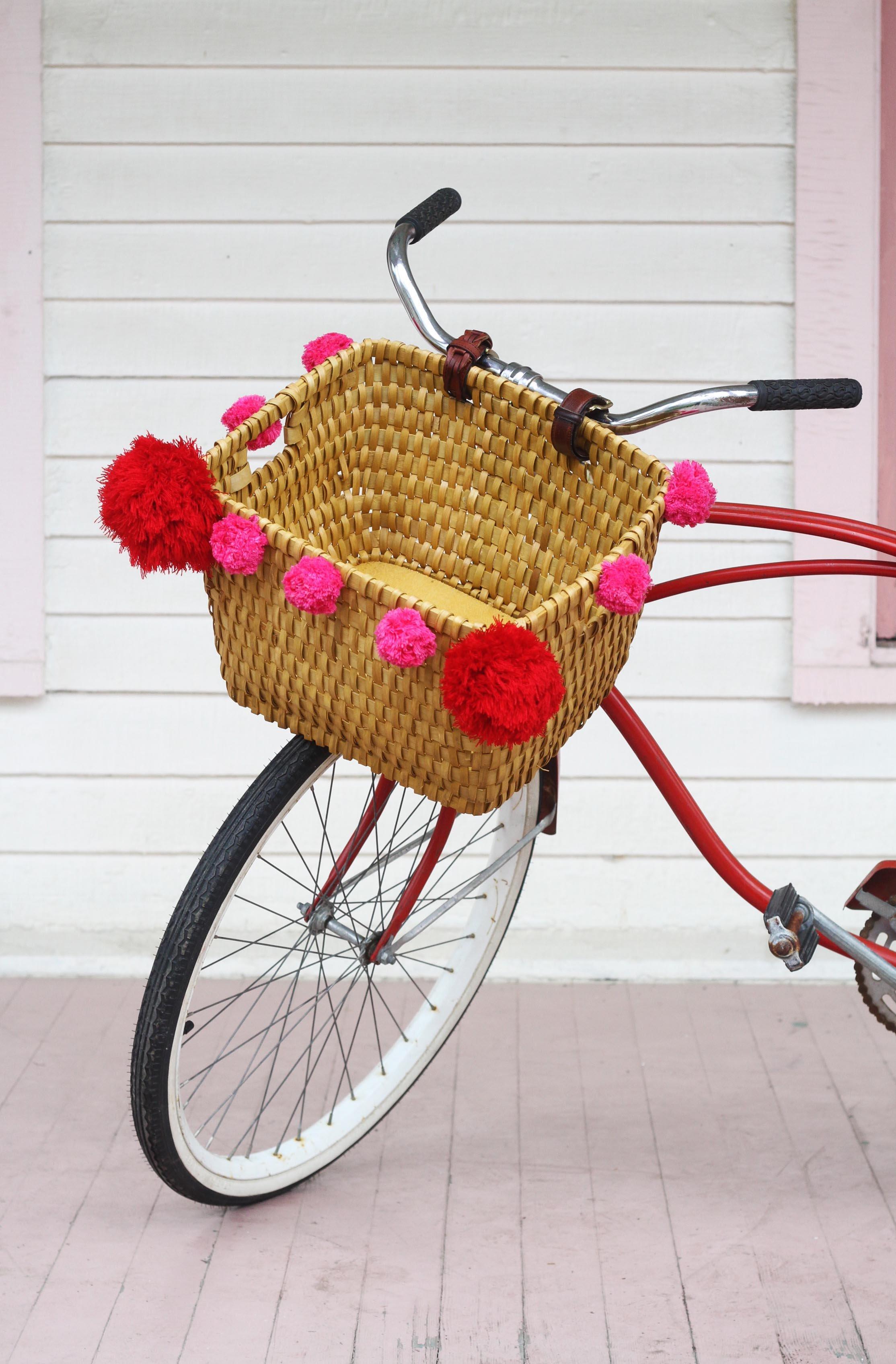 DIY bike basket with large pompoms