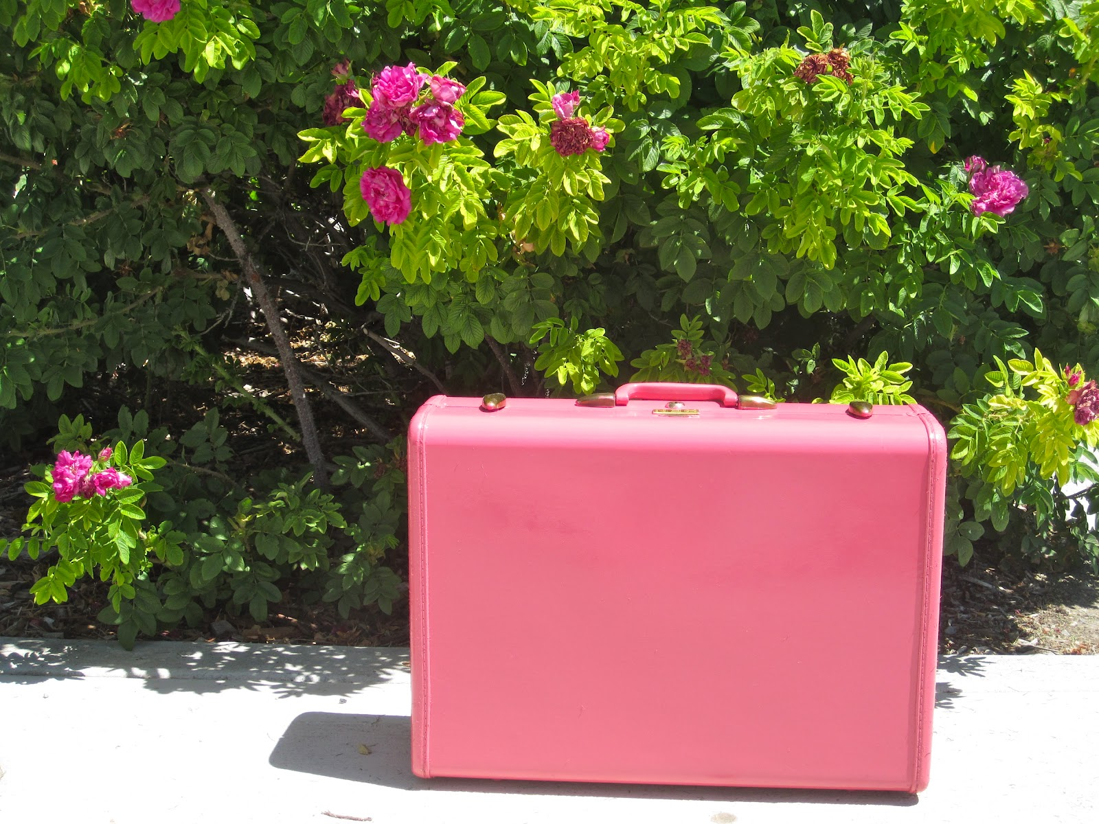 DIY vintage suitcase repainted in pink