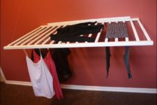DIY wall-mounted drying rack of an old crib