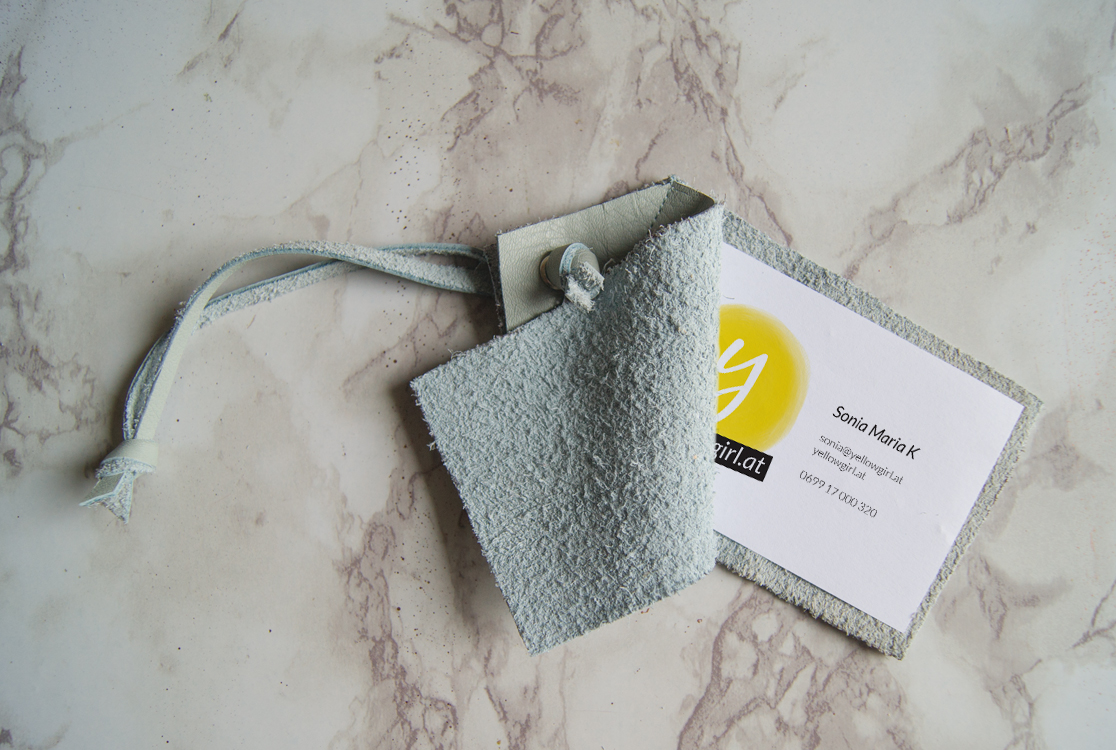 DIY aqua leather tags with visit cards inserted