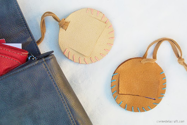DIY round leather luggage tags with stitched edges and opened parts (via www.cremedelacraft.com)