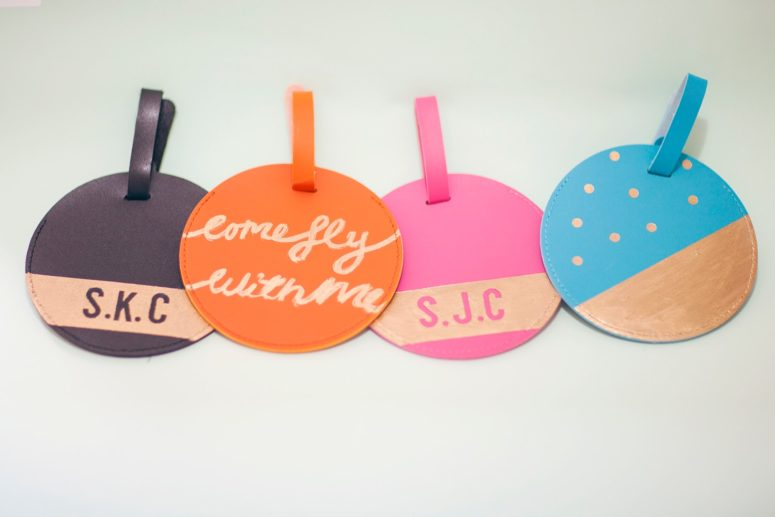 DIY decorated round leather luggage tags (via www.liveitloveitmakeit.com)