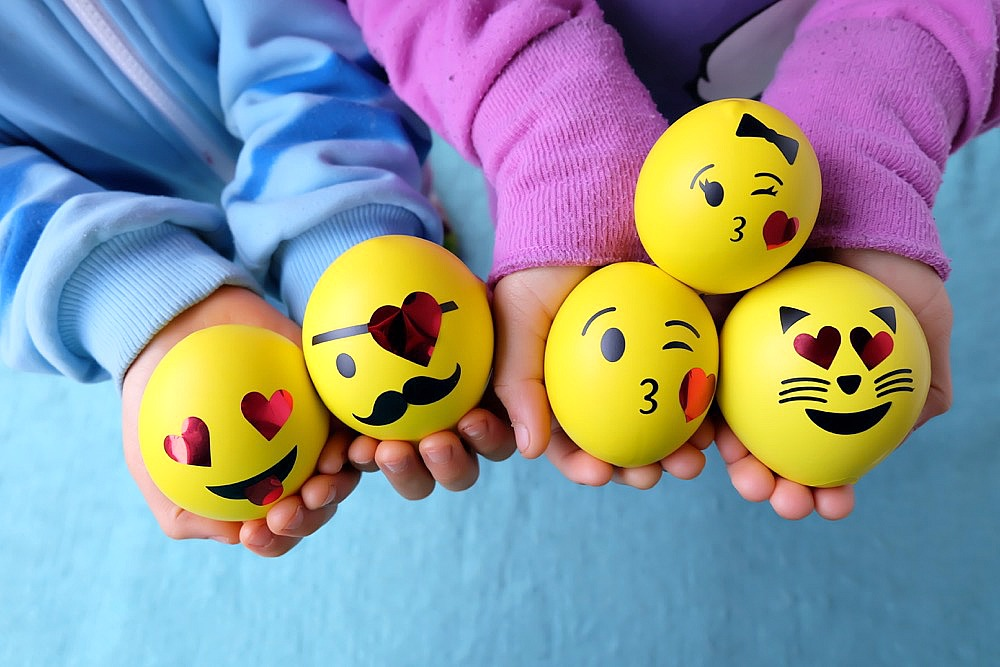 DIY slime filled emoji stress balls