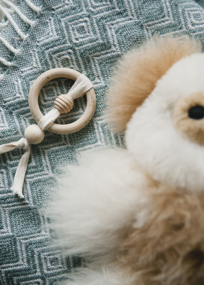 DIY baby teether of wooden beads, ring and ribbons (via www.thekitchykitchen.com)