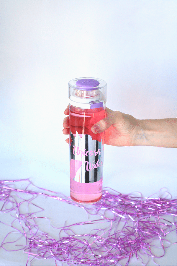 DIY unicorn water bottle using Cricut (via bydawnnicole.com)