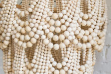 DIY glam wood bead chandelier of beads of different sizes