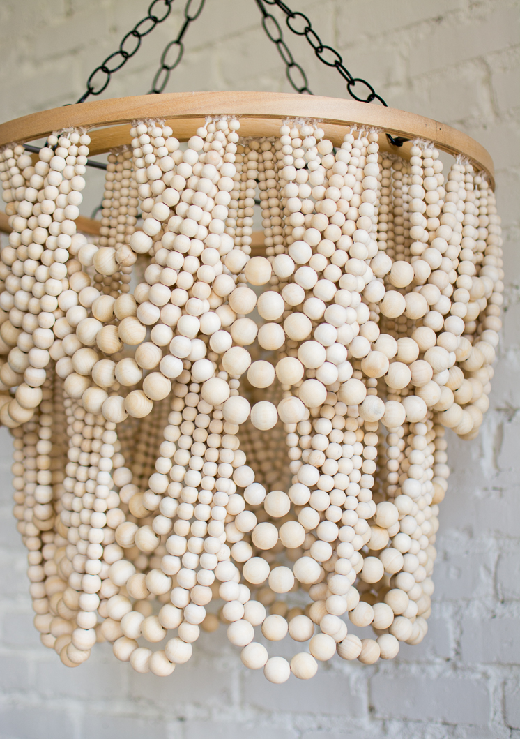 DIY glam wood bead chandelier of beads of different sizes (via thehousethatlarsbuilt.com)