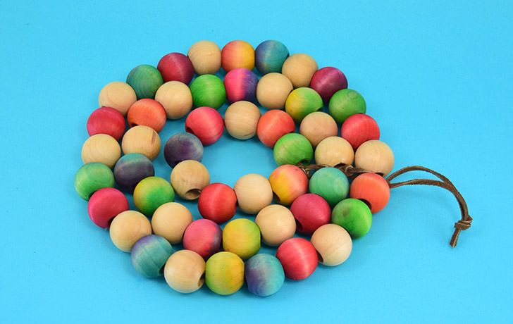 DIY colorful wood bead trivet (via www.dreamalittlebigger.com)