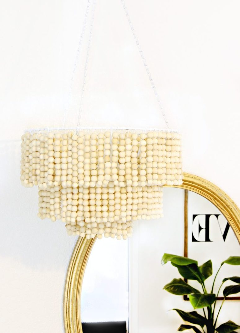 DIY wood bead chandelier with a glam look (via abeautifulmess.com)