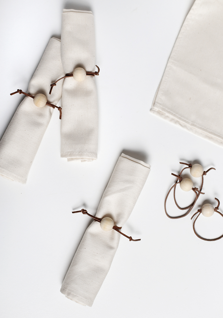 DIY leather cord and wood bead napkin rings (via themerrythought.com)