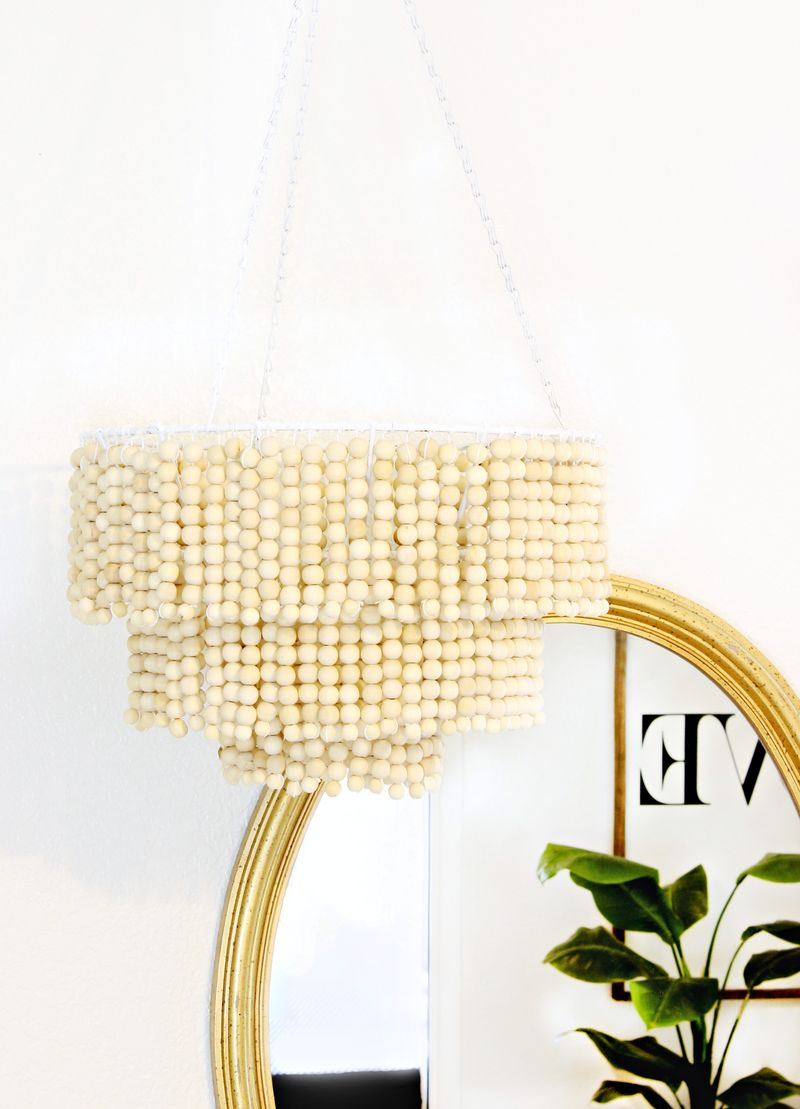 DIY wood bead chandelier with a glam look