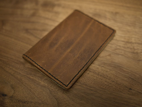DIY hand sewn leather passport holder (via www.designsponge.com)