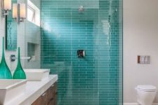 03 a bright turquoise tile wall as a shower accent in a neutral space
