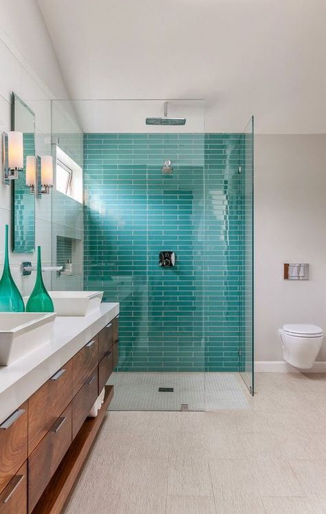 a bright turquoise tile wall as a shower accent in a neutral space
