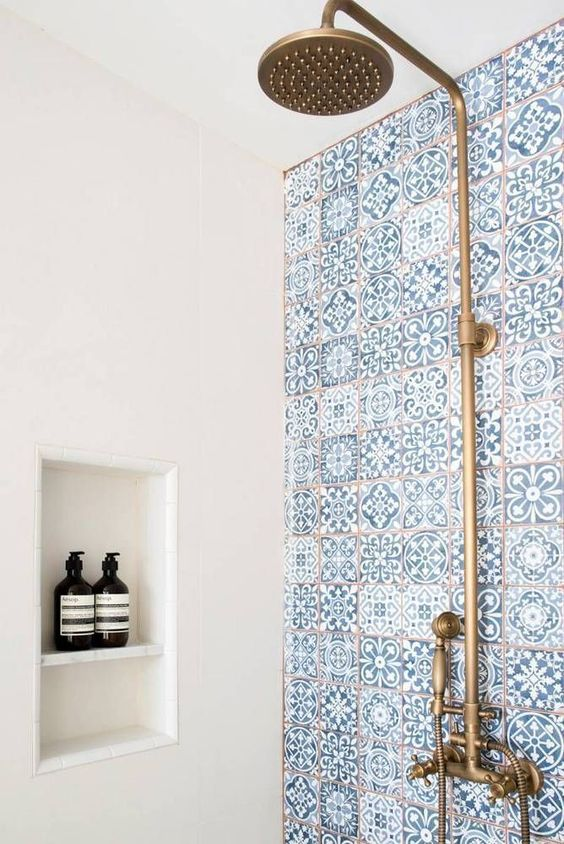 blue mosaic tiles with copper grout and copper fixtures for a chic bathroom