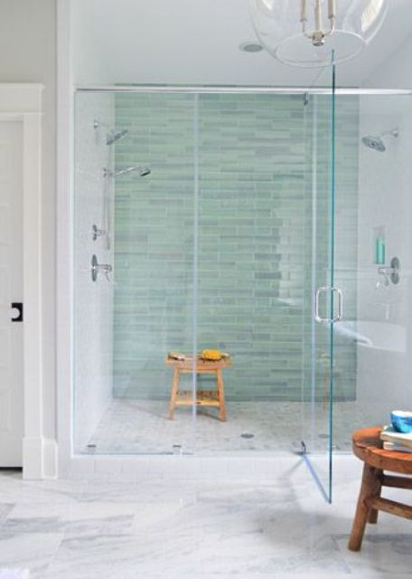 peaceful aqua tiles make taking a shower a relaxing experience